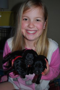 Katherine with the three black girl pups